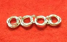Chain Maille Rosette Links | AllFreeJewelryMaking.com