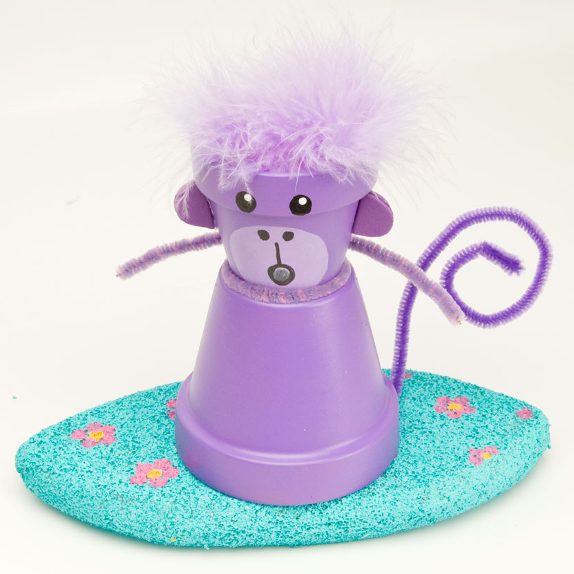 A purple surfing monkey for Surfboard craft for kids