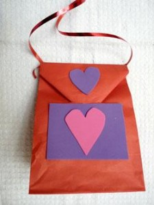 decorate the bag with foam or paper attaching pieces with glue stick